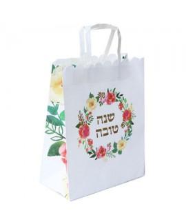 """שקית נייר לבנה בכיתוב """"שנה טובה"""" ובעיטור פרחים"""